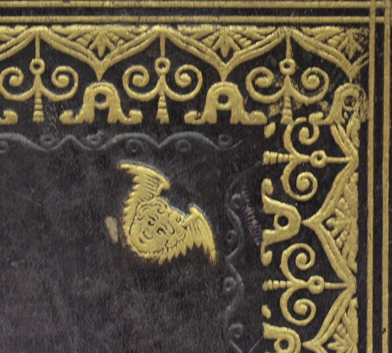 Winged cherub stamp (detail), STC 17546.