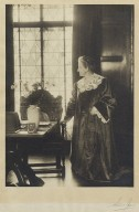 Mrs. Folger standing in the Founders' room (photo)