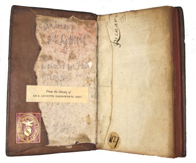 Inside front pastedown and board with manuscript waste endpapers and lacing in boards, STC 11334.