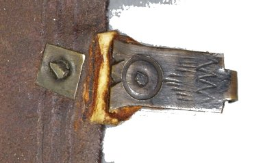 Fore-edge and strap plate, strap, and hasp of clasp with cut brass nails (detail), STC 15142 copy 2.