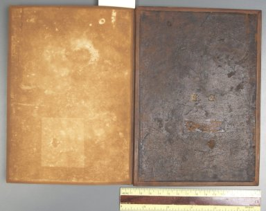 Inside back cover, showing the original dark brown calfskin cover used as a doublure, STC 20477 copy 3.