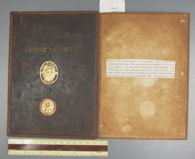 Inside front cover, showing the original dark brown calfskin cover used as a doublure, STC 20477 copy 3.