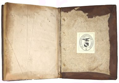 Inside back cover, showing lacing through the boards and endpaper construction of two leaves folded and sewn with double short guards, trimmed at an angle not adhered as pastedowns, STC 24233.