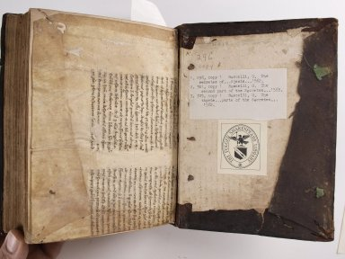 Recycled manuscript from inside back cover, STC 296 c.1.