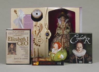 "Various ""pop culture"" items relating to Elizabeth I: Elizabeth Barbie, Elizabeth Rubber Duckie, Elizabeth I video box, Elizabeth R DVD box, Target ad, Elizabeth I CEO book cover"