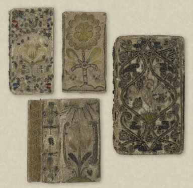 Four embroidered bindings