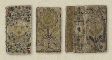 Three embroidered bindings
