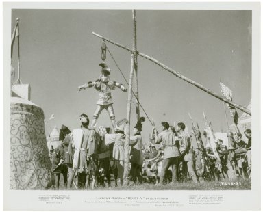Photograph from Laurence Olivier's movie of Henry V: Knight lowered onto horseback.