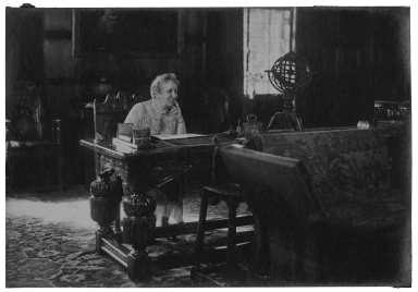 Mrs. Folger seated in the Founders Room (Photo)