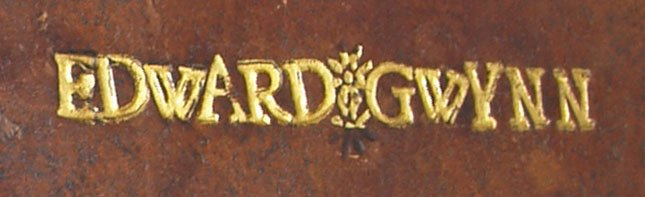 Front cover tooling (detail), name divided by a tooled flower repeatedly stamped on top of each other. The gold was cut too small to cover the entire tool thus leaving the bottom in blind. The letters were tooled in 24 and 30 point type, STC 26101 Copy 3.