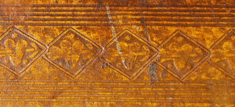 Tooling detail of large pierced heart in lozenge, INC B551.