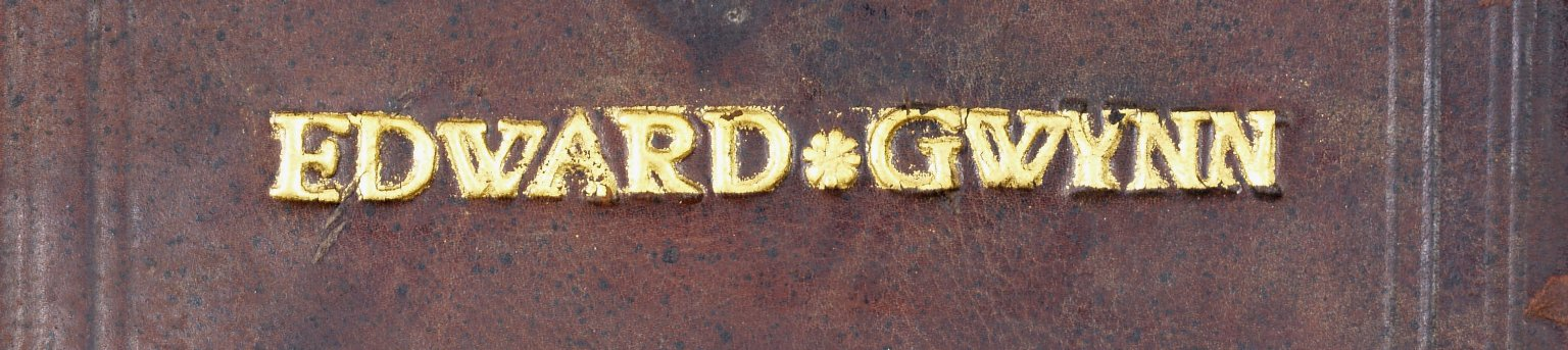 Front cover tooling (detail), name tooled in 26 point type; note the clear horizontal line of gold between the D and G, indicating the edge of the gold, STC 24233.