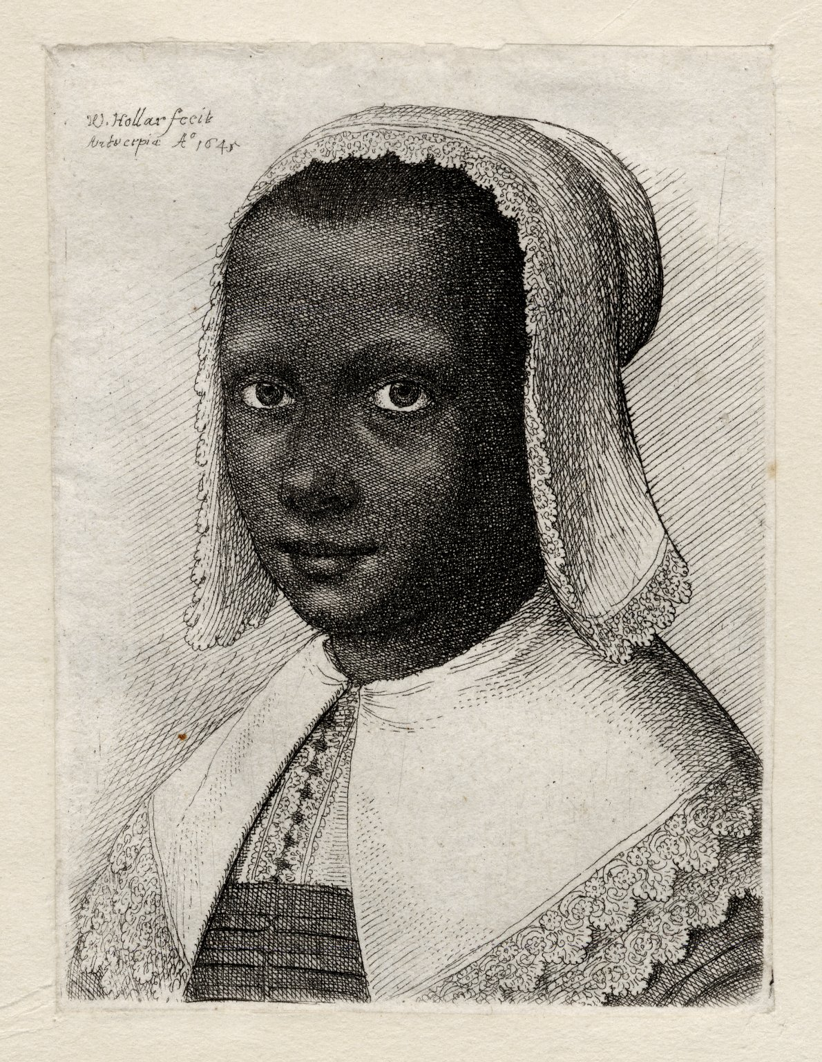 Head of a Black woman with a lace kerchief hat