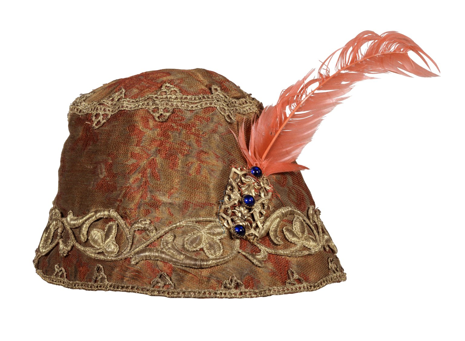 Green and red brocaded cap with gold trim and red feather