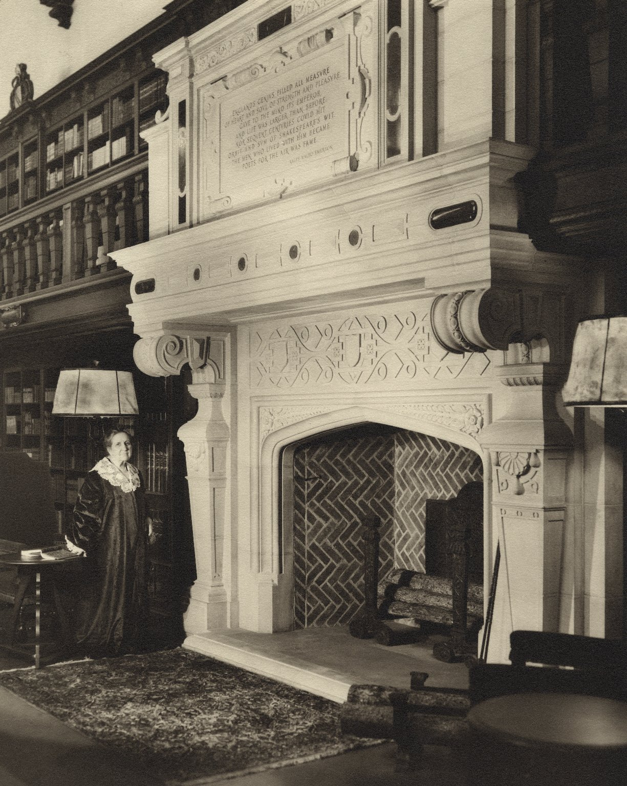 Mrs. Folger standing in front of the fireplace in the Reading Room (photo)