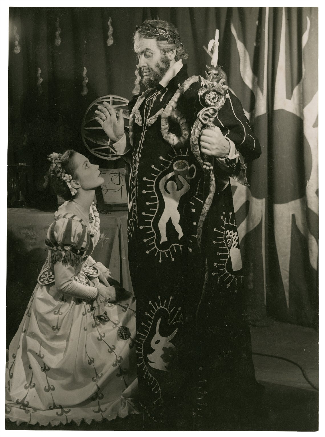 Actors from the Tempest in costumes designed by C. Walter Hodges